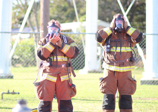 Firefighters putting on turnout gear